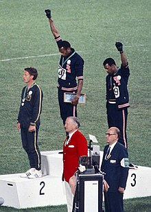 220px-John_Carlos,_Tommie_Smith,_Peter_Norman_1968cr.jpg